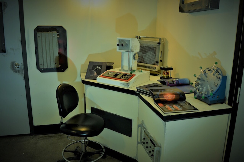 In game at The Locked Room. A science lab with a assortment of lab equipment.