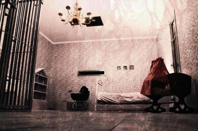 In-game: The Girl's Room with a bed, a baby carriage, a dollhouse, a magnificent chandelier, and a cage.