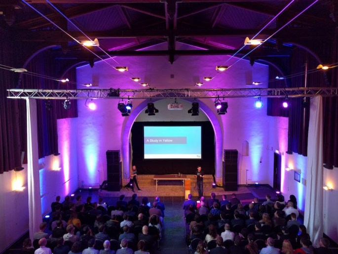 Lisa and David on stage speaking to a full house in the chapel on the prison dome.