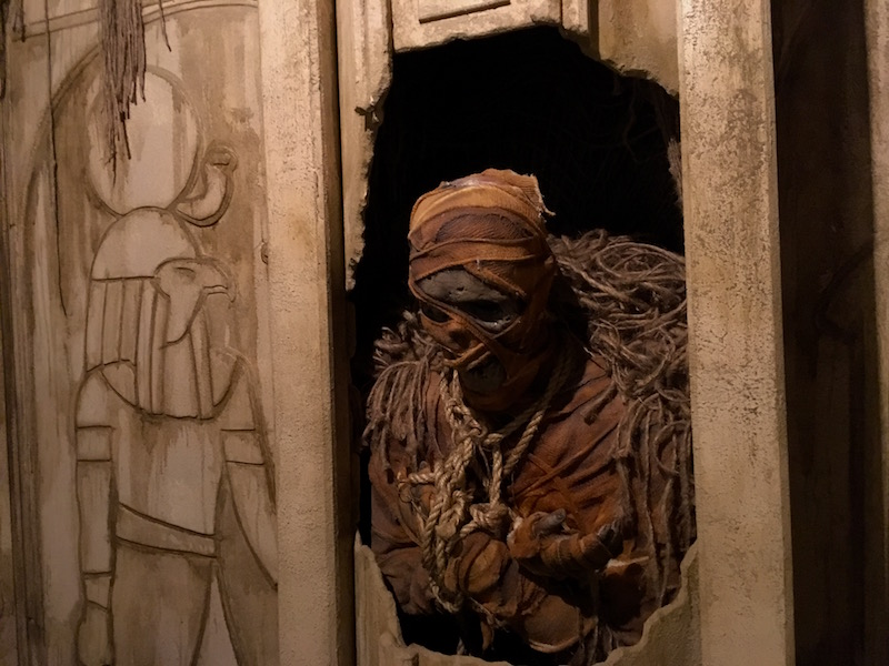 In-game: A decaying mummy behind a broken wall.
