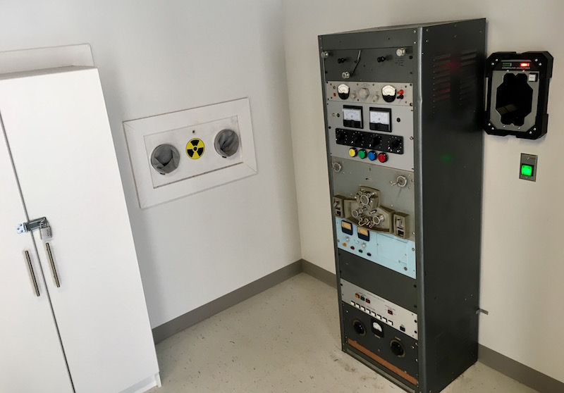In game: A laboratory setting with large machinery and a locked cabinet.