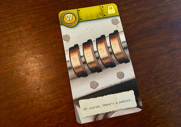 """Yellow card depicting a combination padlock. The flavor text of the cards reads, """"Of course, there's a padlock."""""""
