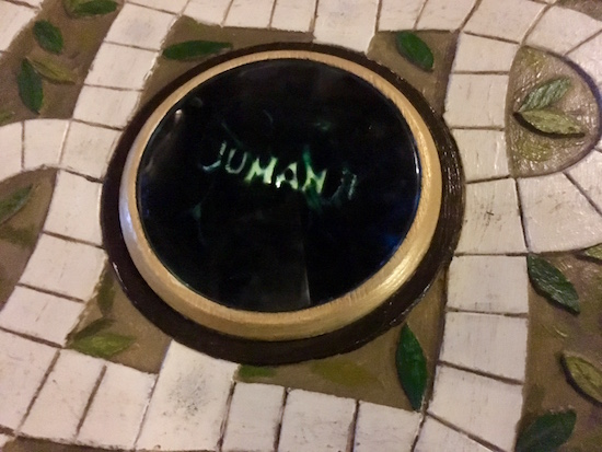 "In-game: A close up of the message window on a Jumanji board. It reads, ""Jumanji."""