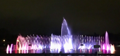 Giant fountain, lit purple.
