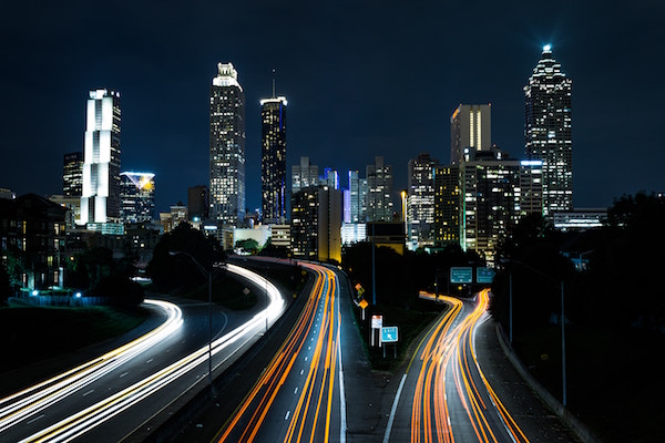 The highways of Atlanta in a time-lapse photo at night. Car lights looks like lasers.