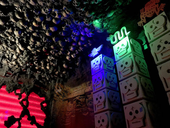 In-game: 4 pillars of skulls, above them, the ceiling is covered in skulls.