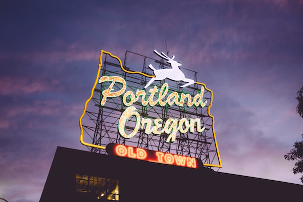 Massive neon Portland, Oregon sign with an illuminating buck.
