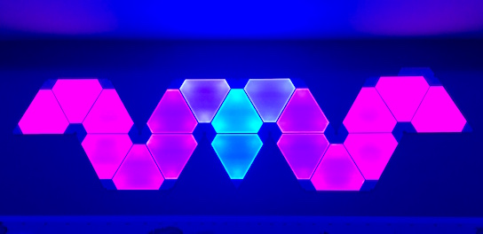 In-game: A blue and purple glowing wall hanging.