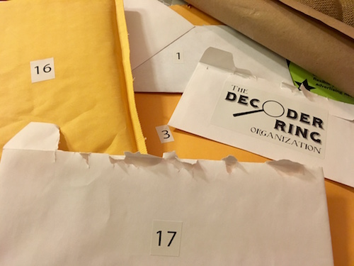An assortment of Decoder Ring packages. There are all types of packages all individually numbered.