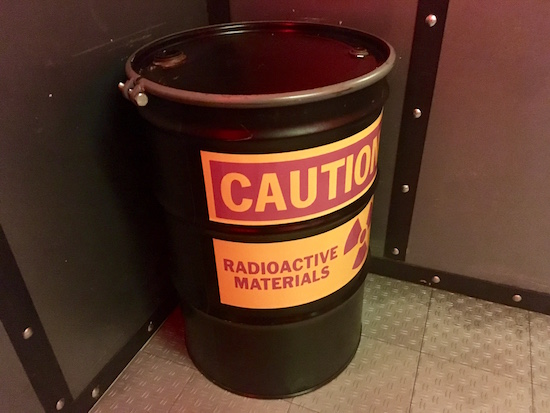 "In game: A barrel labeled ""CAUTION Radioactive materials"""