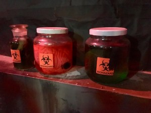 In-game: 3 jars filled with mysterious fluids, all labeled with biohazard stickers.