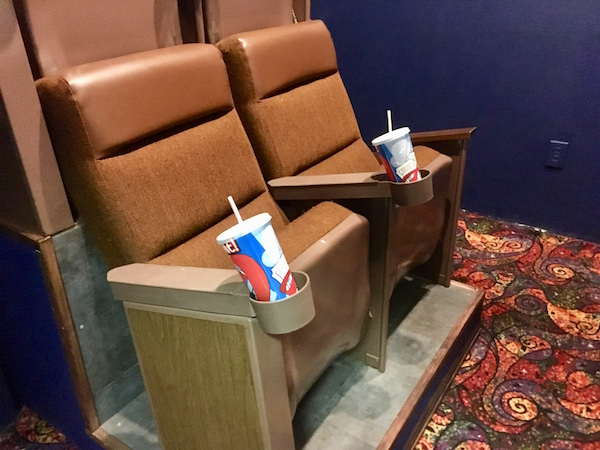 In-game: A set of 4 movie theater seats in a small theater.