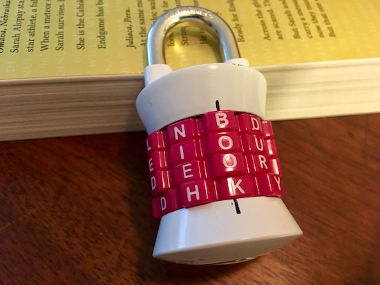 "Master Lock letter lock 1235DWD with the word ""BOOK"" appearing as the combination."