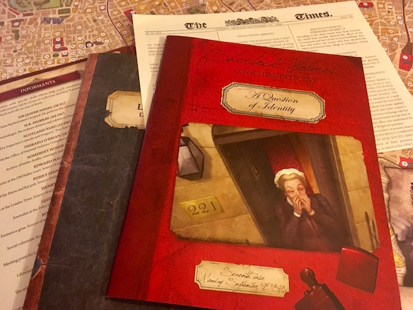 The game's map, a case book, a newspaper, the informants list, and the London Directory laid out on the table.