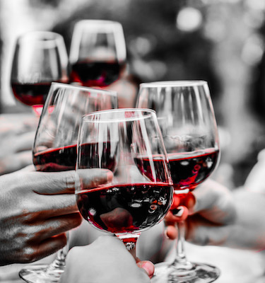 Black & white & red photos of hands clinking wine glasses.