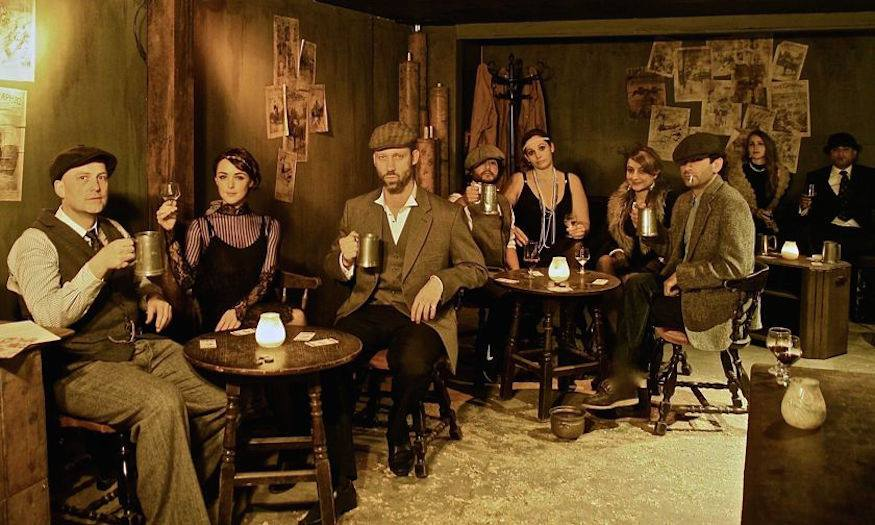 A group of period dressed me and women in a speakeasy.