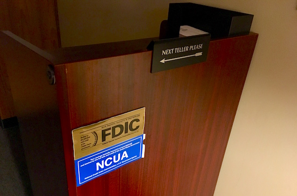 "In-game: A lectern that reads, ""Next Teller Please."""