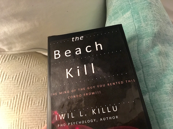 "In-game: the cover for the book, ""The Beach Kill."""