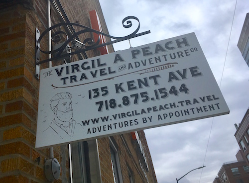 Virgil A Peach Travel and Adventure Co's hipster signage.