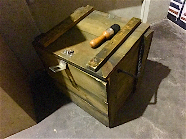 In-game: a large wooden crate and a brush.