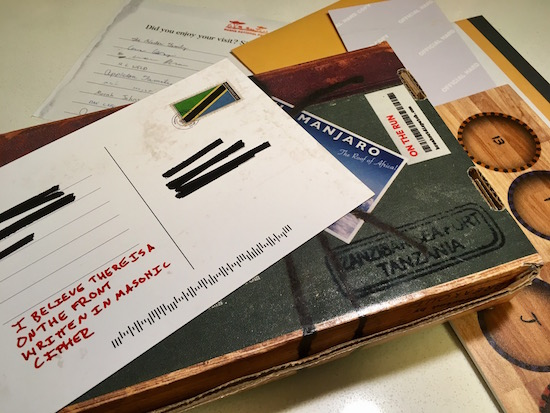 """Dispatch by Breakout – On the Run, Box 5 assorted papers from the box and a post card that reads, """"I believe there is a on the front written in masonic cipher."""""""