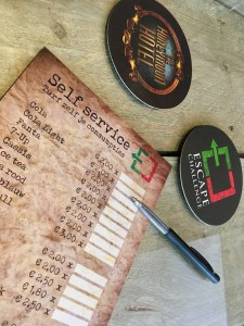 Escape Challenge's lobby self service food and drink price list/ form.