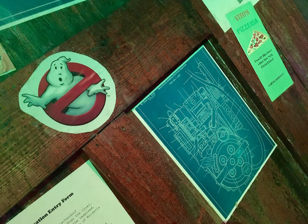 In-game: A close up of the proton pack schematics and the Ghostbusters logo.