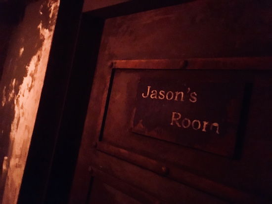 """In-game: A close up of a heavy metal door labeled """"Jason's Room."""""""