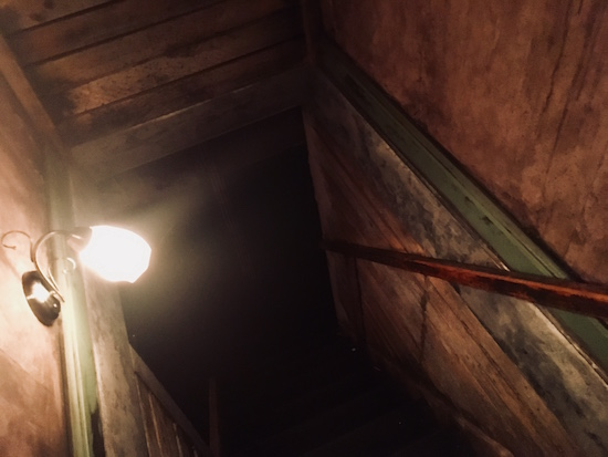 In-game: A heavily weathered stairwell down to a basement.