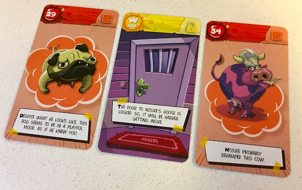 In-game: Three cards one featuring a dog, another Noside's front door, and the last is a cow modified with a funny glass brain helmet.