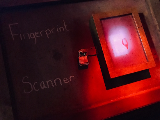 In-game: a fingerprint scanner secured with a padlock.