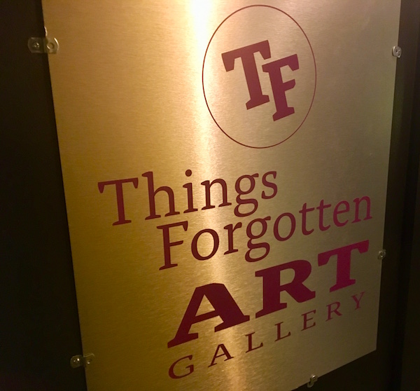 "In-game: Sign for ""Things Forgotten Art Gallery."""