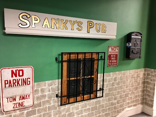 In-game: The exterior for Spanky's Pub with a gated window, and no parking signs.