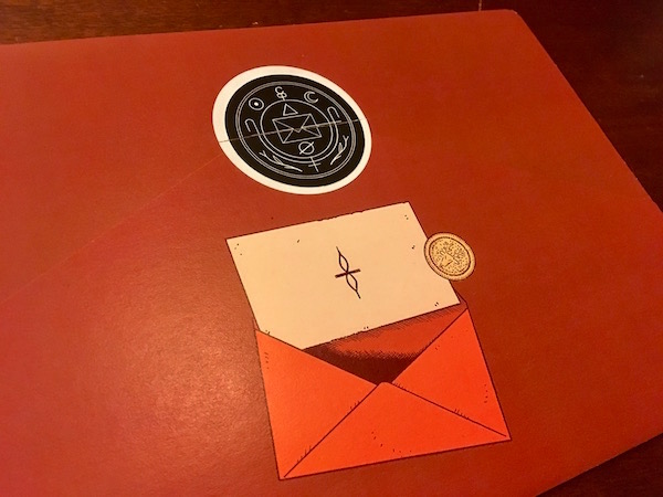 The back of one of the Cryptogram Puzzle Post envelopes. Sealed and with the illustration of a letter emerging from an envelope.