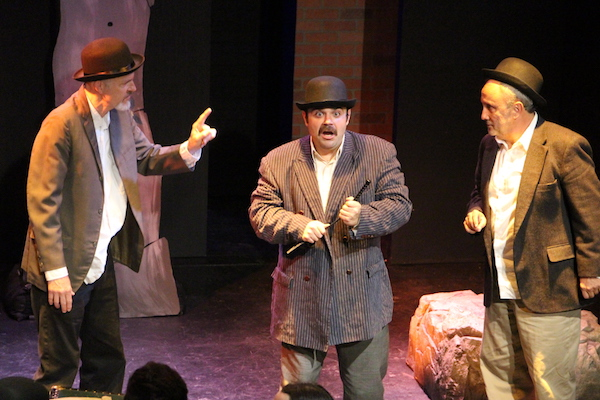 In-game: Three actors performing a scene. One actor looks very surprised.