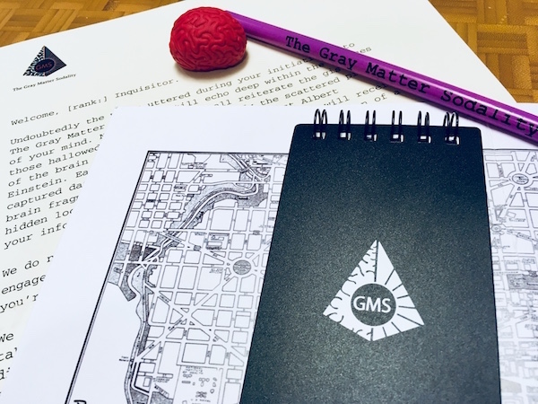 In-game: A pencil, plastic brain, GMS notebook, map, and a letter from The Gray Matter Sodality.