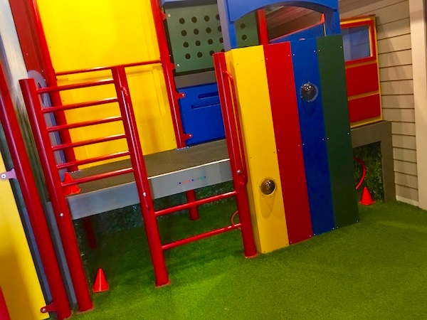 In-game: a bright and colorful jungle gym on green turf.