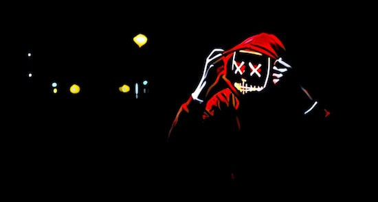 A man in a hoodie with an scary LED mask.