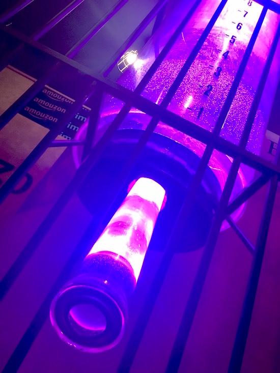 In-game: a massive hamster water dispenser, lit purple.