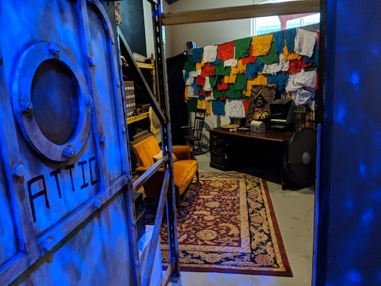 A view into the Museum of Intrigue's attic, a storage space filled with assorted items.