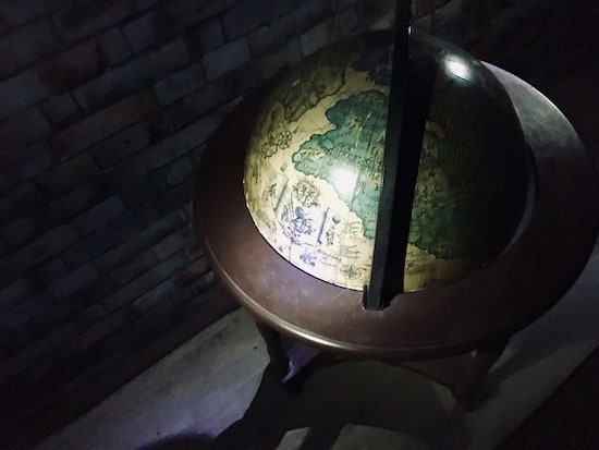 In-game: a globe in a dark room.