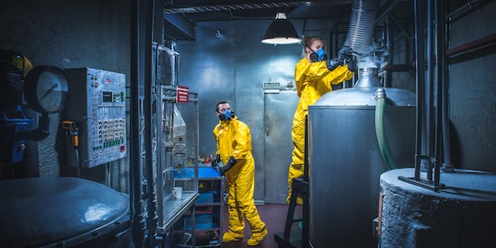 Claustrophobia game promo: two people in yellow suits and masks in a lab