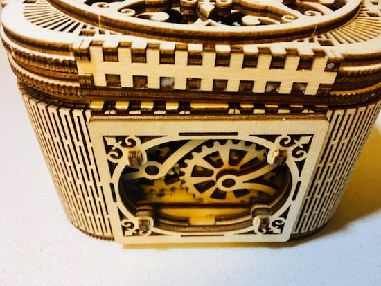 Left side of the the completed treasure box. An internal geared mechanism is exposed.