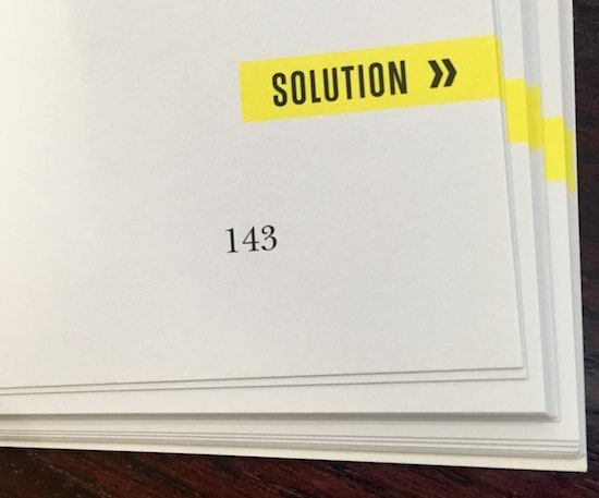 In-book, page shows that the puzzle's solution is on the next page.