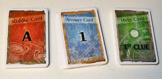 Stacks of riddle, answer, and help cards.