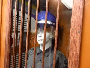 In-game: a ticket booth with a mannequin wearing a conductor's uniform.