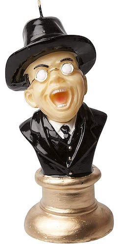 A candle made to look like the bust of Toht, the vile Nazi from Raiders of the Lost Ark.