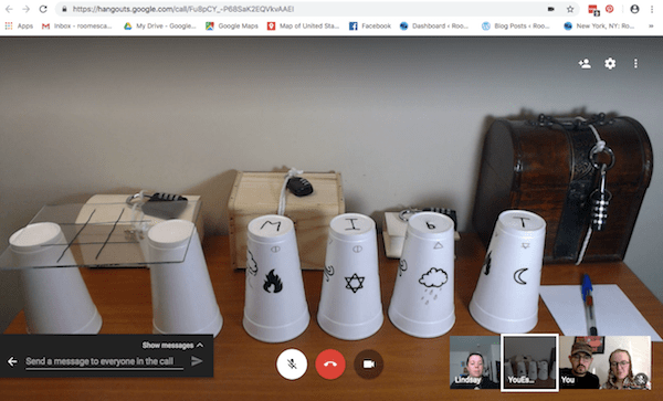 Google Hangout: The initial game setup features many locked boxes and styrofoam cups, some with drawings on them.