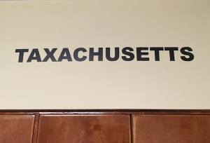 "In-game: the word ""Taxachusetts"" painted boldly on the wall."