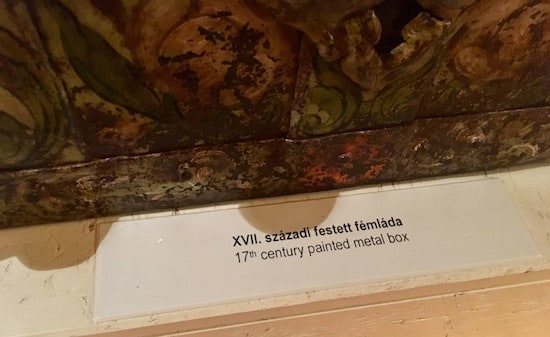 """Label reads """"17th century painted metal box"""""""